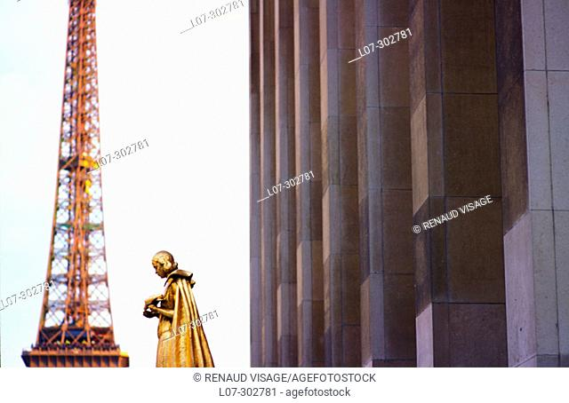Golden statue, Eiffel Tower and Palais de Chaillot. Paris. France