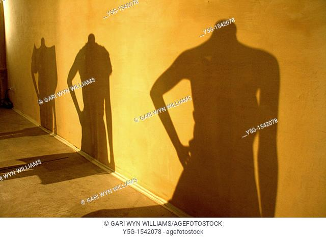 shadow of female mannequins at fashion event