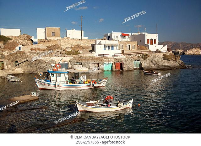 Traditional fishing boats and houses with boat shelters in the village of Goupa, Kimolos, Cyclades Islands, Greek Islands, Greece, Europe