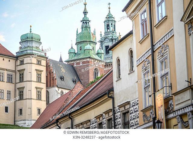 Wawel Royal Castle looms on hill over historic townhouses, Krak—w, Lesser Poland Voivodeship, Poland