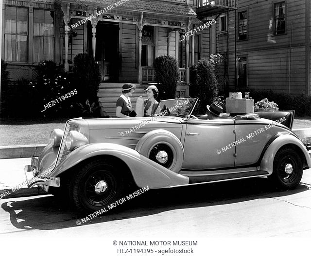 Auburn 8 Convertible Coupe, 1934. In a scene from the Columbia Motion Picture White Lies (1934), Robert Allen sits in the car while Fay Wray and Irene Hervey...