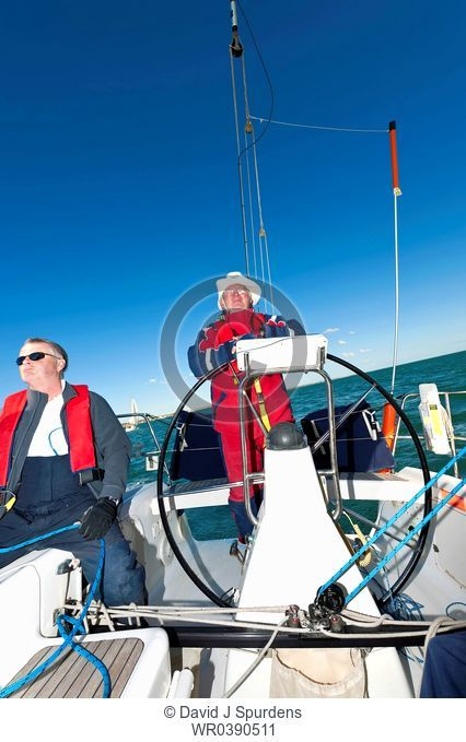 Ocean going yacht with captain at the wheel