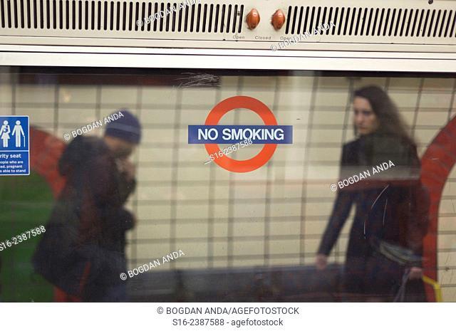 London Underground station seen through a tube's carriage window - UK, EU, Europe