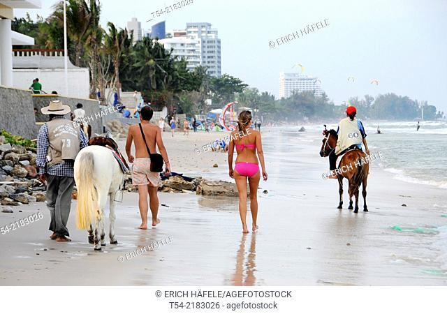 Locals and tourists on the beach in Hua Hin
