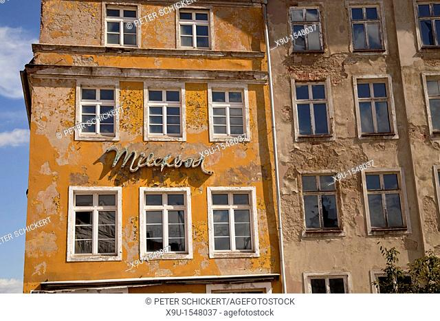 GDR neon sign 'Milchbar' on a decaying facade, Hanseatic City of Stralsund, Mecklenburg-Vorpommern, Germany