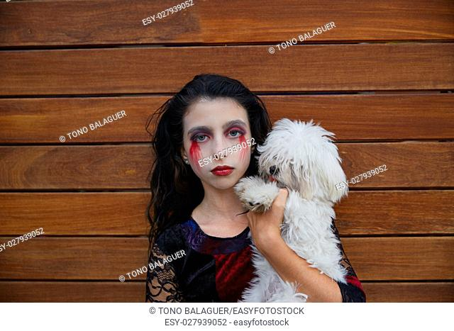 Halloween kid girl custome with bloody makeup on wooden wall