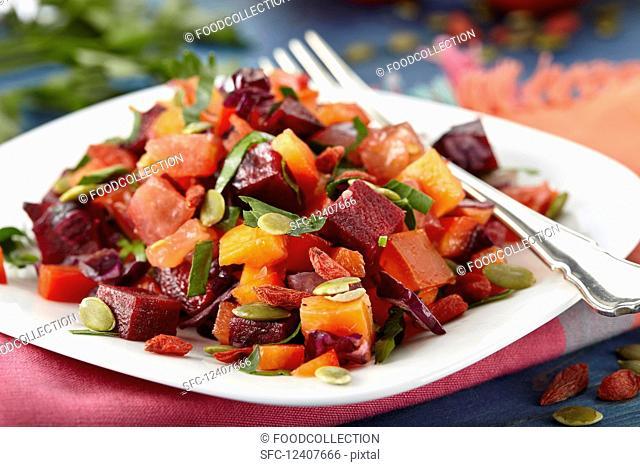 Vegan beetroot salad with carrots and pumpkin seeds