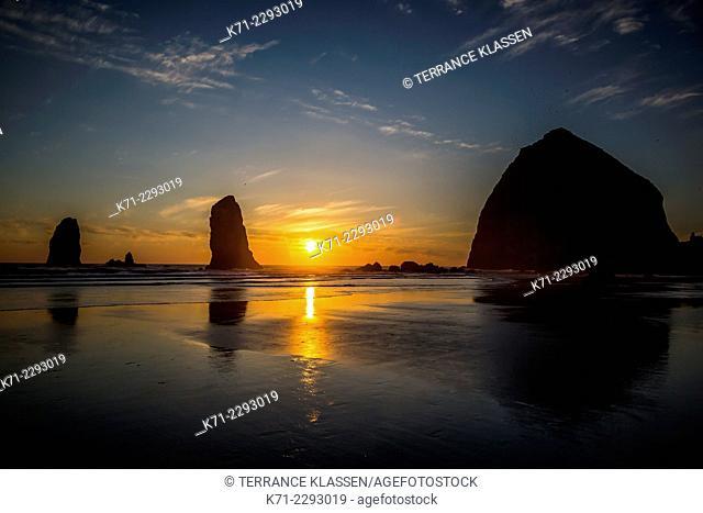 The Canon Beach haystacks at sunset on the Oregon coast, USA