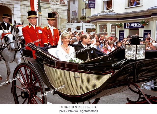 The groom Prince Edward and his bride Sophie Rhys-Jones after the Church Wedding drive in a carriage, waving at the cheering crowd, pictured on 19th June 1999