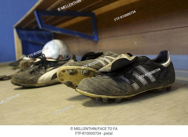 Soccershoes and a ball in the locker room