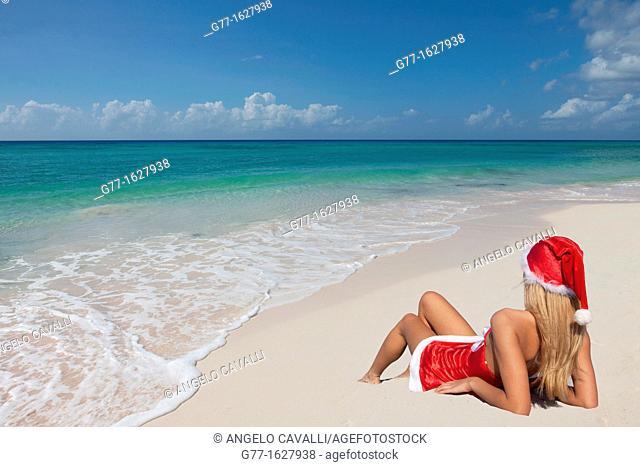 Woman with Santa's hat on the beach, Miami, Florida, USA