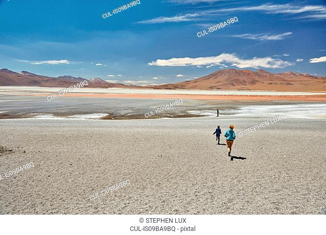 Mother and sons exploring landscape, Laguna Colorada, Colorada, Potosi, Bolivia, South America