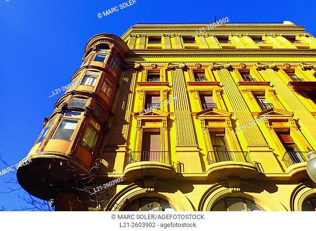 Old yellow apartment building. Gracia quarter, Barcelona, Catalonia, Spain