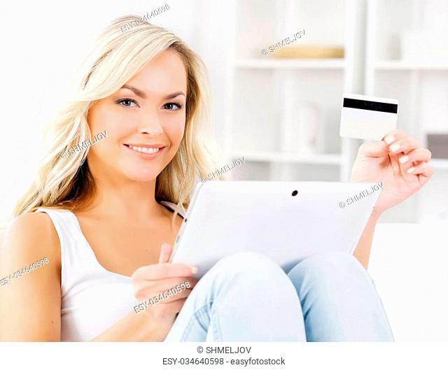 Online shopping concept. Beautiful blond girl with a credit card