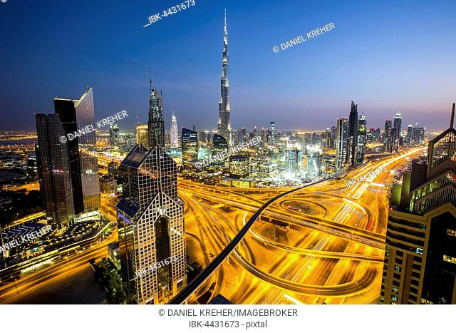 View of skyline from Shangri La Hotel at dusk, illuminated Sheikh Zayed Road, Burj Khalifa, Downtown, Dubai, United Arab Emirates