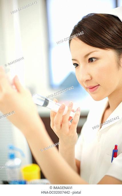 Nurse preparing for injection