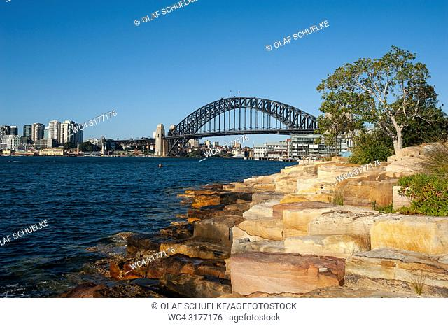 Sydney, New South Wales, Australia - A view from the shores at Millers Point in Barangaroo of the Sydney Harbour Bridge and Kirribilli in North Sydney in the...
