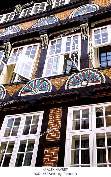 Germany, Stade, brick building facade with open windows