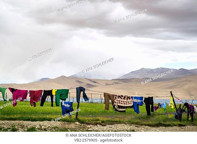 Drying Clothes on the fence. Nomads campsite during their summer festival in Tso Moriri lake, Ladakh (India)