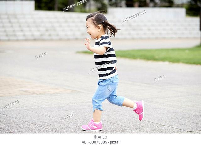 Japanese kid in a city park