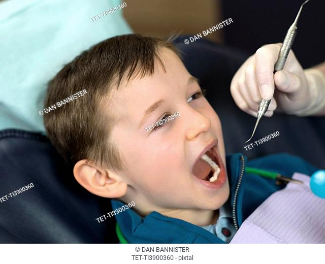 Dentist and patient in dental surgery