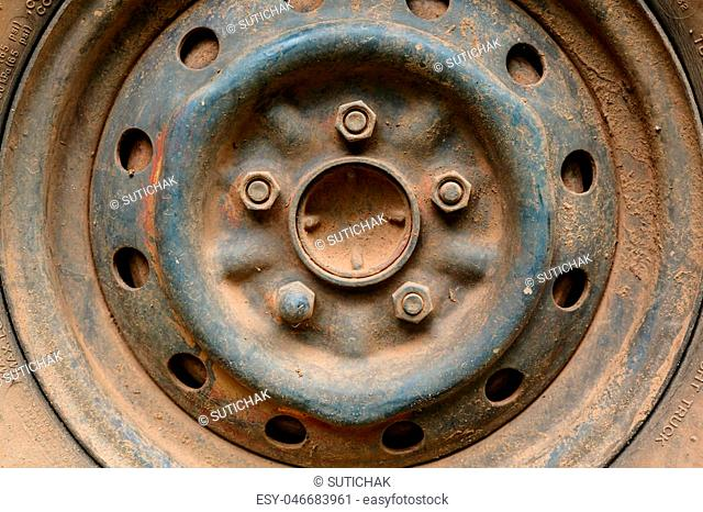 old rusty metal alloy wheel car vehicle