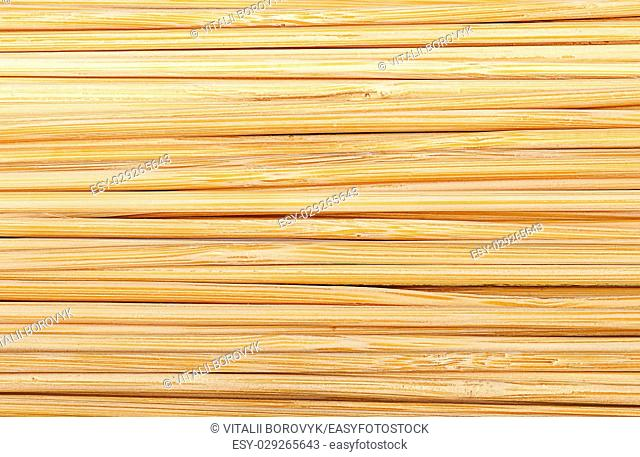 Closeup abstract background of bamboo sticks stacked next to each other