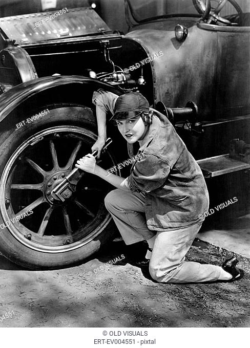 Portrait of female mechanic working All persons depicted are not longer living and no estate exists Supplier warranties that there will be no model release...