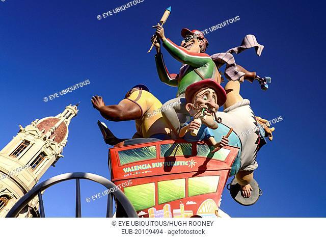 Las Fallas scene with Papier Mache figures on a Bus Turistic in Plaza Ayuntamiento during Las Fallas festival