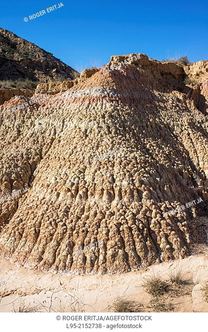 Erosion by wind and rainfall on slopes of clayish ground including strata of different colors, Monegros, Spain