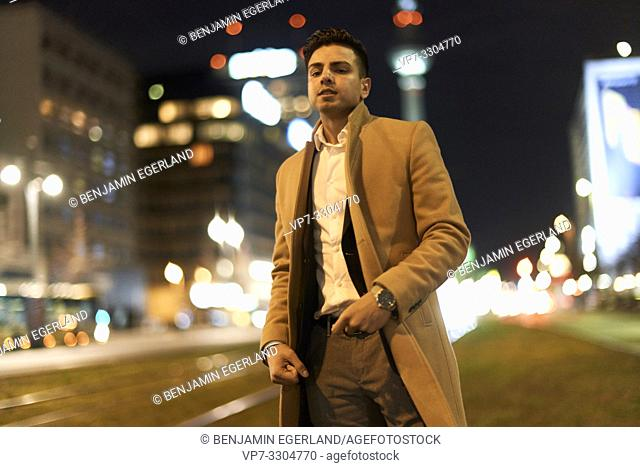 young man at night, in city Berlin, Germany