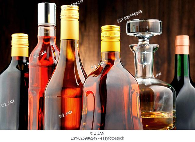 Composition with bottles of assorted alcoholic beverages
