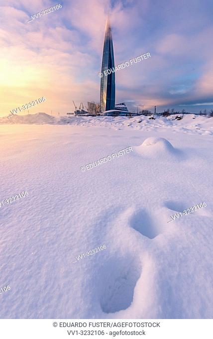 "SAINT PETERSBURG. RUSSIA - January 27 2019. Skyscraper """"Lakhta center"""" (Gazprom headquarters) twilight. Frozen sea side view against sunset sky"
