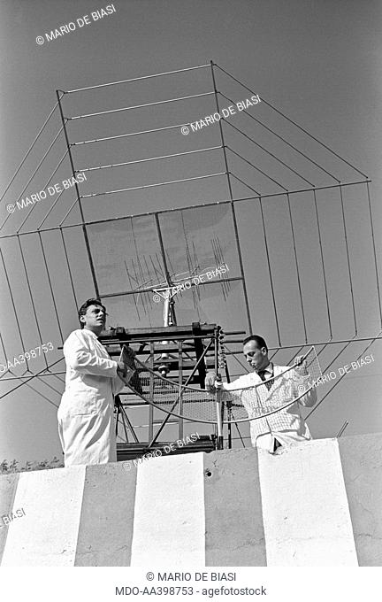 Italian brothers and radio amateurs Achille and Giovanni Battista Judica Cordiglia settling an antenna to listen to Soviet and American astronauts' voices...