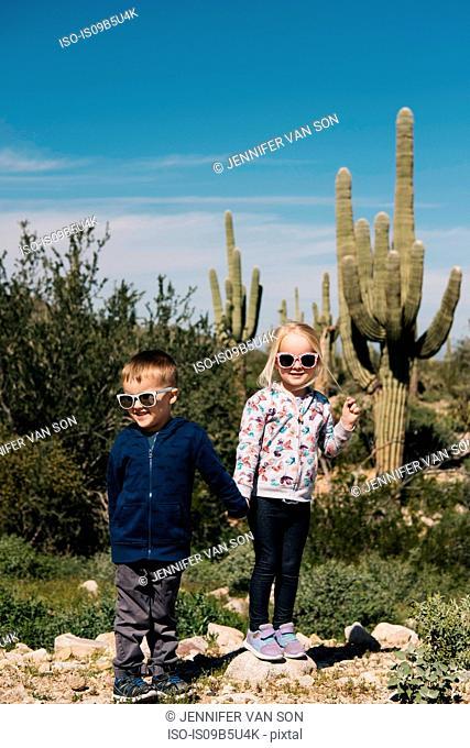 Boy and girl holding hands, Wadell, Arizona, USA