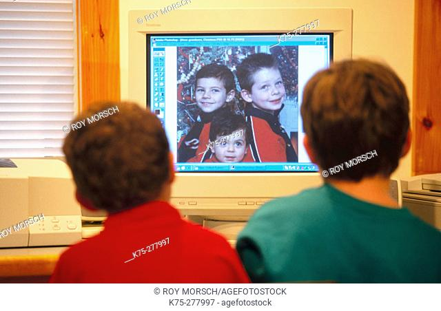 young boys looking at computer monitor