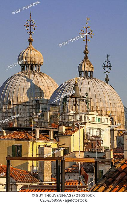 The domes of Basilica di San Marco seen over the roofs from a window, San Marco, Venice, Italy