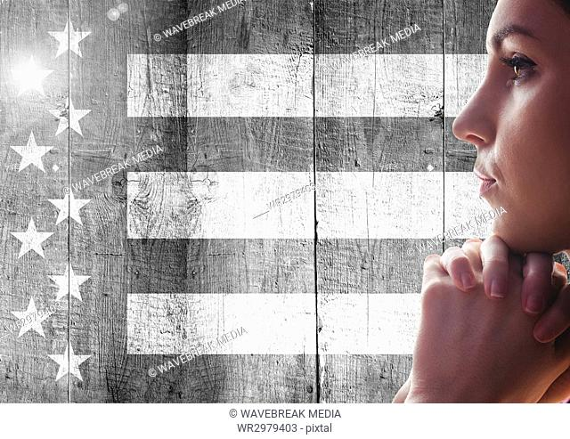Woman thinking against black and white american flag