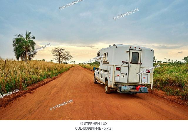 Campervan driving on dirt road, Pantanal, Mato Grosso, Brazil, South America