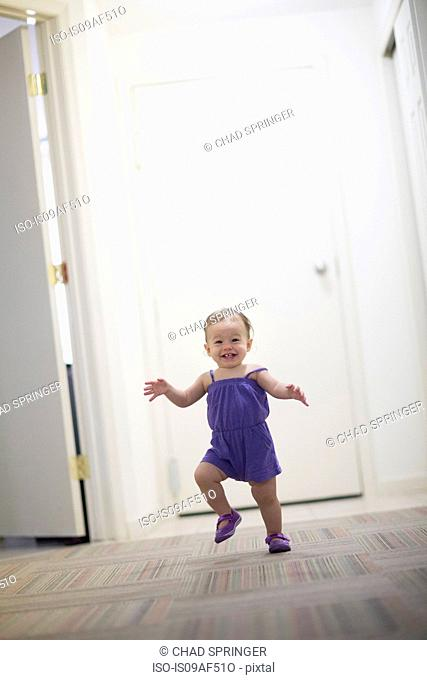 Toddler girl learning to walk