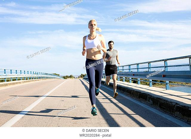 Young couple jogging on the waterfront