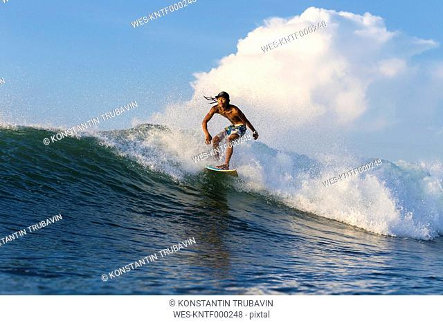 Indonesia, Lombok, Surfer on a wave