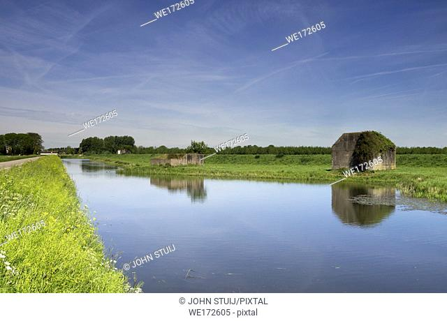 Concrete bunkers along a ditch at Sleeuwijk in the Dutch province of Noord-Brabant