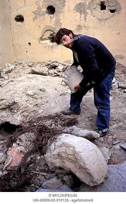 Examining damaged STATUE near THOLING dates back to the 10th Century in the GUGE KINGDOM west of MOUNT KAILASH - TIBET