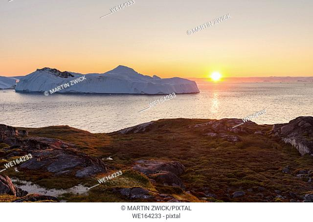 Ilulissat Icefjord also called kangia or Ilulissat Kangerlua, sunset over Disko Bay. The icefjord is listed as UNESCO world heritage