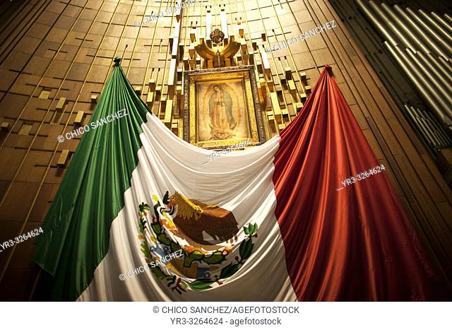 The altar with the original image of Our Lady of Guadalupe decorated with a Mexican flag in Nuestra Señora de Guadalupe Basilica in Mexico City, Mexico