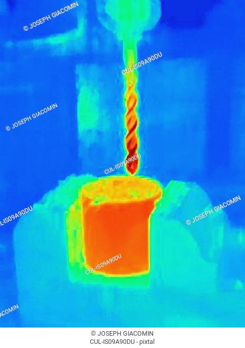 Thermal image of drilling into a component, showing the heat bulidup on the drill bit and the part