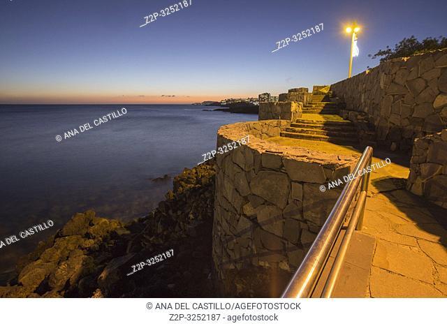 Los Abrigos, Tenerife, Spain - January 2, 2019: Picturesque bay in Los Abrigos by night. Los Abrigos is a small fishing village in Granadilla de Abona in the...