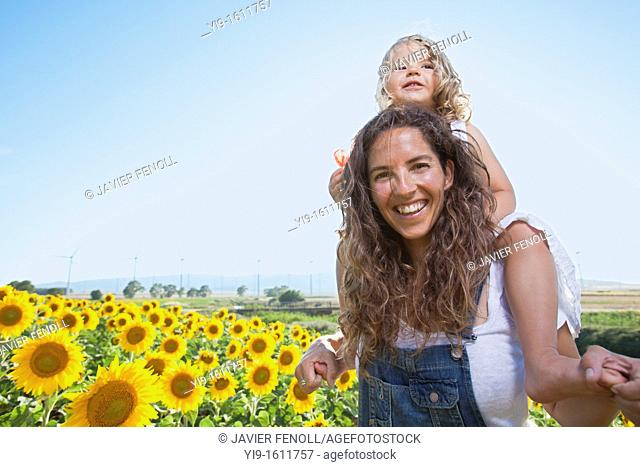 mother and daughter in a field of sunflowers