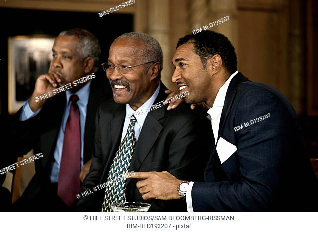 African American businessmen smiling